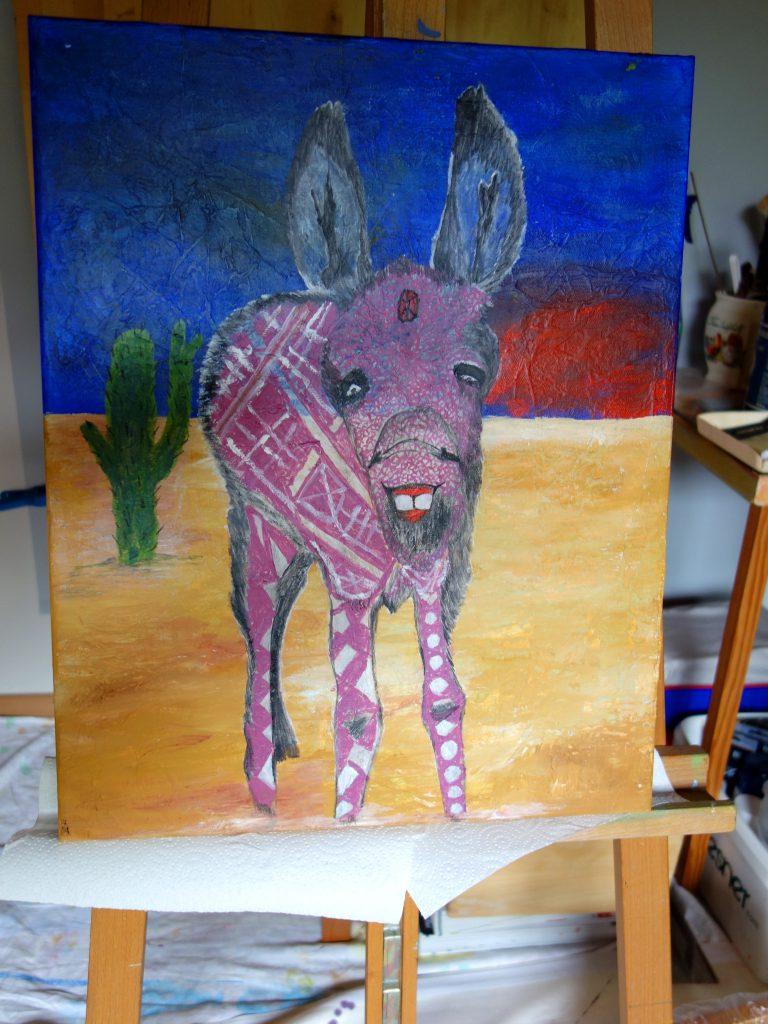 Abstrakter lila Esel mit Kaktus in der Karibik